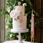 Wedding cake with tapered candles on the side