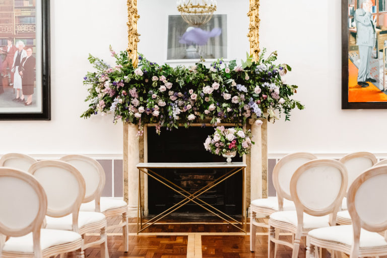 Wedding ceremony setup in front of a fireplace