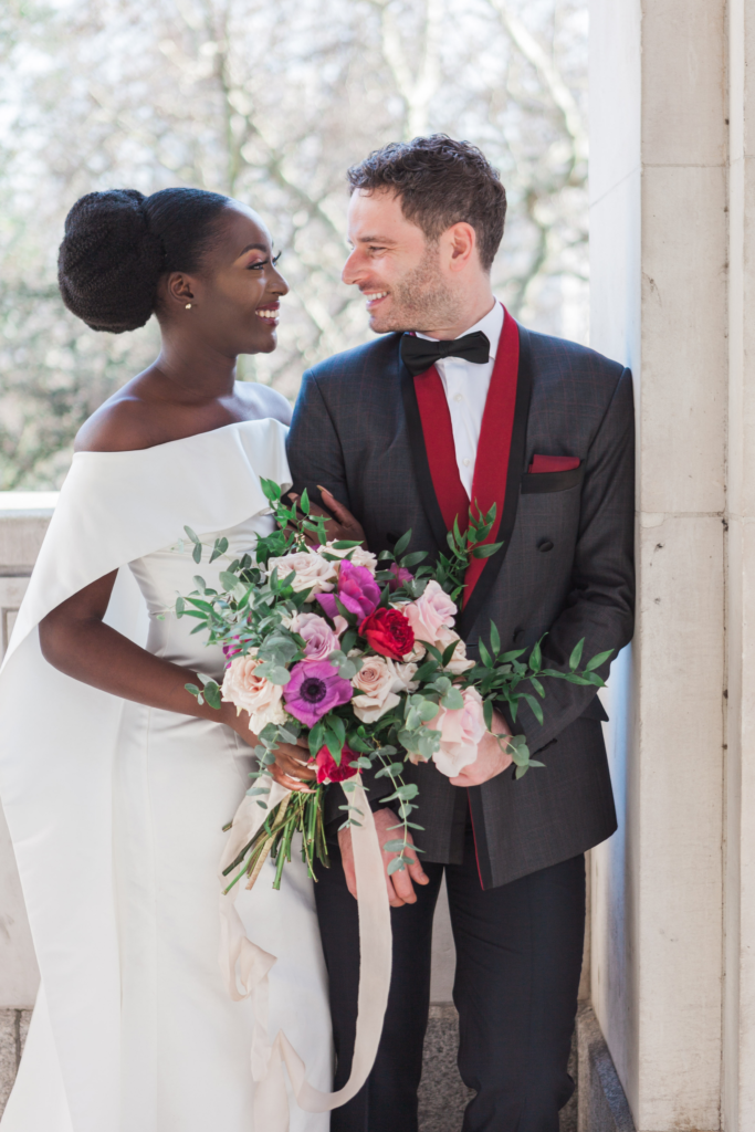 Interracial couple arm in arm at their wedding