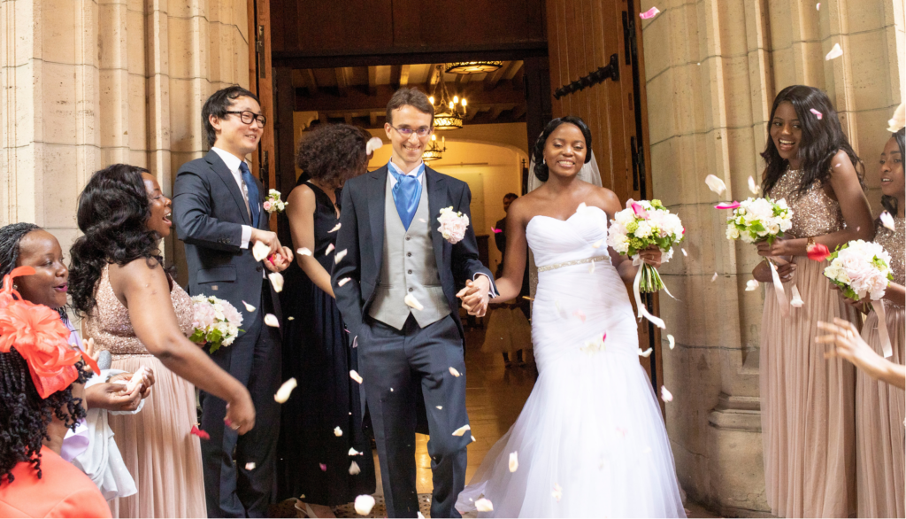 Newly married couple leaving the church